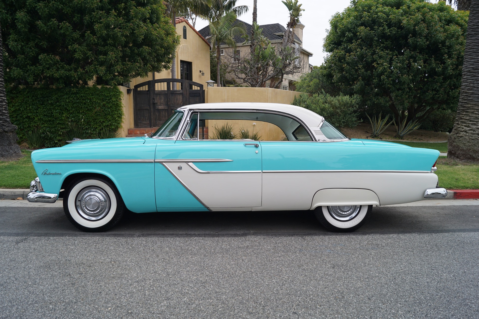Longest lowest liveliest plymouth ever plymouth ad for 1955 plymouth belvedere 4 door sedan